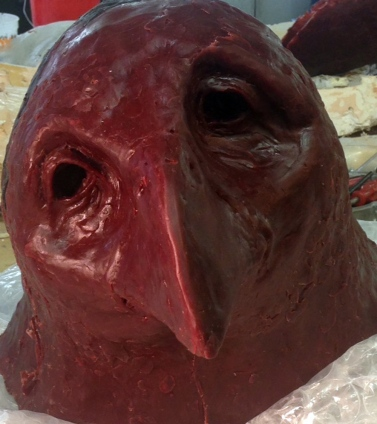 Head of the 6-foot bird wax state