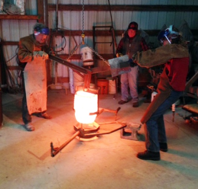 Gary and I pouring bronze